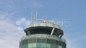 An air traffic control tower on a sunny day.