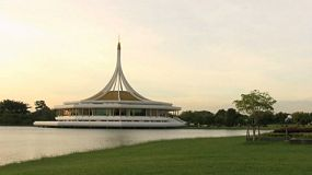 A funky cool Thai style museum building stands majestically near a pond in Bangkok, Thailand.
