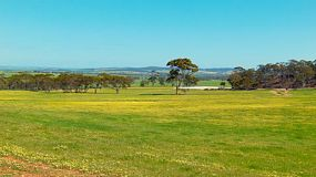 View across paddocks in a valley on an Australia farm in spring.