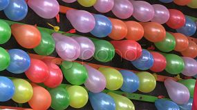 Balloons being popped at an amusement park by young kids throwing darts. (HD 1080p30)