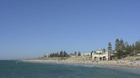 People swimming and enjoying Cottesloe Beach in Perth, Western australia, on a hot summer day.