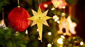 Star and bauble decorations hanging on a christmas tree.
