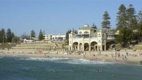 Cottesloe beach in Perth, Western Australia, on a hot day in summer, with many people enjoying the popular beach to escape the heat.