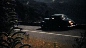 Old cars driving through the lovely Blue Ridge Mountains on a family vacation in 1940.