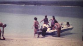 A family enjoys going for a boat ride on their holidays at the beach in Caracas, Venezuela in the summer of 1978.