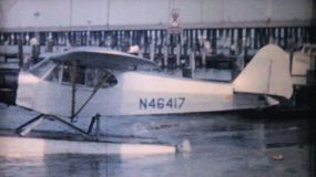 A shiny new float plane sits in the harbor waiting for take off in Ocean City, New Jersey in 1958.