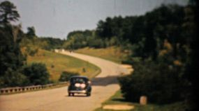 Old cars driving down the new highway in Virgina in 1940.