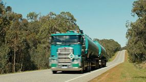 A fuel tanker road train travelling down a highway in country Australia.