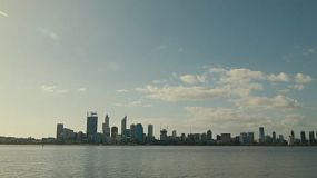 Timelapse of Perth City from across the Swan River on a clear afternoon, with light clouds.