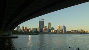 Time lapse of the Perth City skyline, framed by the underside of the Narrows Bridge and the Swan River.