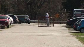 A kid playing ball hockey on rollerblades on the street. It doesn't get anymore Canadian than this!