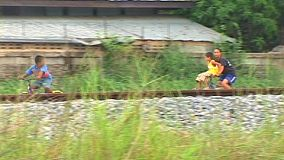 Riding bicycles behind a railway line