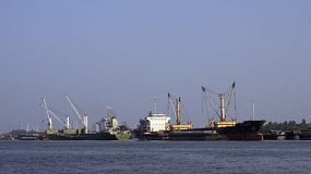 Container ships moored in the Chao Phraya River at  Khlong Toei Port in Bangkok, Thailand.