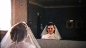 A beautiful teenage girl prepares for her first communion after her confirmation classes are finished.