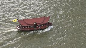 A small traditional Thai style ferry on the Chaophraya River in Bangkok, Thailand.