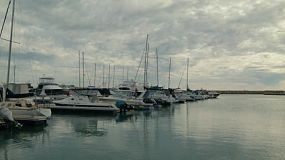 Time lapse of a row of yachts moored at Coogee Marina in Perth, Western Australia on a cloudy day.