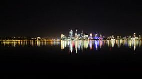 Time lapse of the lights of the Perth City skyline at night, reflecting on the calm waters of the Swan River.