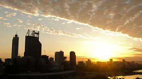Time lapse of sunrise over Perth City skyline with clouds moving over.