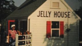 A local town cryer rings his bell outside the Jelly House in Provincetown, Massachusetts in 1940.