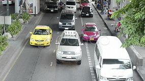 Traffic jam during rush hour on a busy road in Bangkok, Thailand, with the sound of a pssing ambulance.