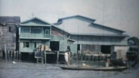 Classic footage of traveling the rivers and canals by long tail boat in Bangkok, Thailand in 1958.