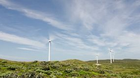 Timelapse of windmills/ wind turbines set against cloudy blue skies at the Albany wind farm in Western Australia - alternative energy.