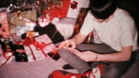 A young man gets a new pair of socks for Christmas in 1967.