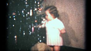 Girl Eats Chocolate By Christmas Tree (1940 Vintage 8mm)