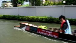 A Thai style boat cruises down a flooded street during the floods of Bangkok, Thailand in 2011.