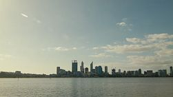 View of the Perth City skyline from across the Swan River in the afternoon on a clear winter afternoon.