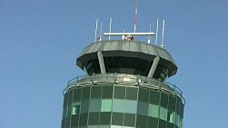 A close up of an airport control tower on a sunny day. (HD 1080p30)