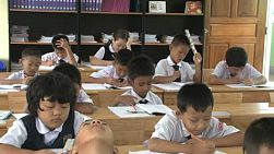 A group of Thai school kids do their school work in the classroom in Chiang Mai, Thailand.