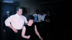An attractive couple demonstrates their amazing dance moves at the company Christmas party in December 1962.