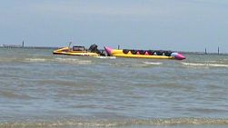 A banana boat lazily waits for action riding the gentle ocean waves.