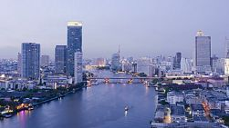 A time lapse of the Chao Phraya River in Bangkok, Thailand at dusk.