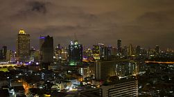 Timelapse of skyscrapers and buildings in Bangkok, Thailand at night.
