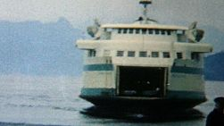 A BC Ferry slowly arrives at its destination on Vancouver Island in the summer of 1966.