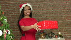A beautiful Thai girl presents a lovely Christmas gift during the holidays.