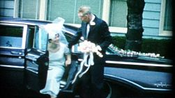 A beautiful bride shares a tender moment with her Dad before her wedding in 1967.