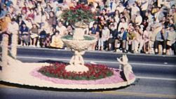 Crowds enjoy the big summer time parade with all the decorated cars, floats and horses in 1967.