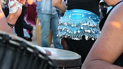 A belly dancer shakes her booty to the rhythm of the djembe drums at the Venice Beach Drum Circle.