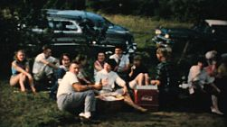 Friends and family members enjoy lots of great food, fun and conversation at the big family reunion BBQ picnic in the summer of 1959.