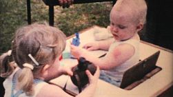 A caring, concerned big sister looks after her little baby sister during the summer of 1959.