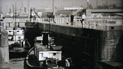 A fishing boat goes through the locks in Seattle, Washington in 1940.