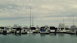 Row of yachts and boats moored at Coogee Marina in Perth, Western Australia.