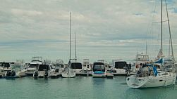 Timelapse of boats moored in a marina, with a yacht entering, at Coogee Marina in Perth, Western Australia.