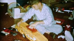 A boy gets a cool Tonka truck set on Christmas Day morning in 1962.