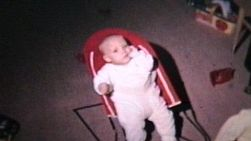 Boy In A Baby Bouncer In 1964 (Vintage 8mm film footage).