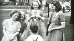 Boys and girls laughing and playing together and enjoying each others company in the summer of 1955.