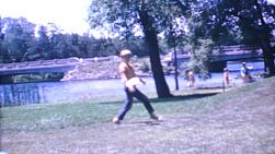 A couple of blond haired boys enjoy playing frisbee together while on family vacation in the summer of 1967.